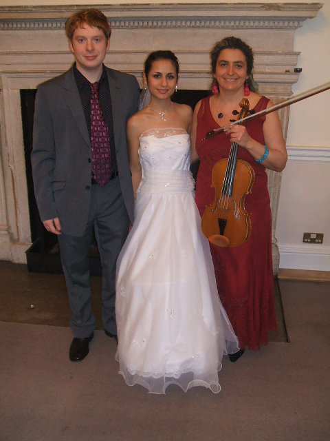 Happy couple and professional wedding musician at civil wedding ceremony and reception in Woodstock Town Hall, near Oxford. Your favourite music played on the mellow viola