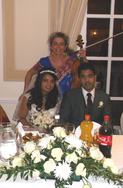 Happy couple at Asian wedding reception. Bollywood music played by professional wedding musician in Oxford. Ceremony, reception, your favourite music played on the mellow viola