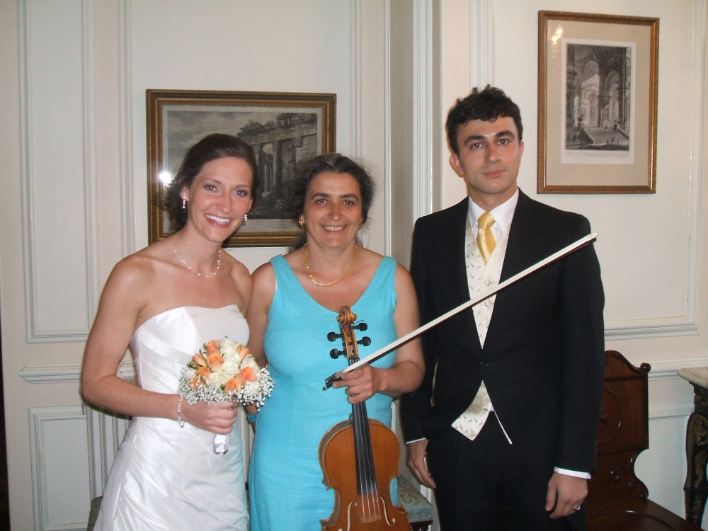 Just married couple with professional wedding musician in Oxford St. John's College. Violin, viola. Ceremony, reception, your favourite music played on the mellow viola