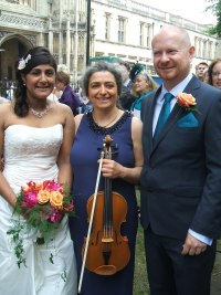 Wedding musician in Oxford with viola for another ceremony and reception. In the background is Christ Church Cathedral