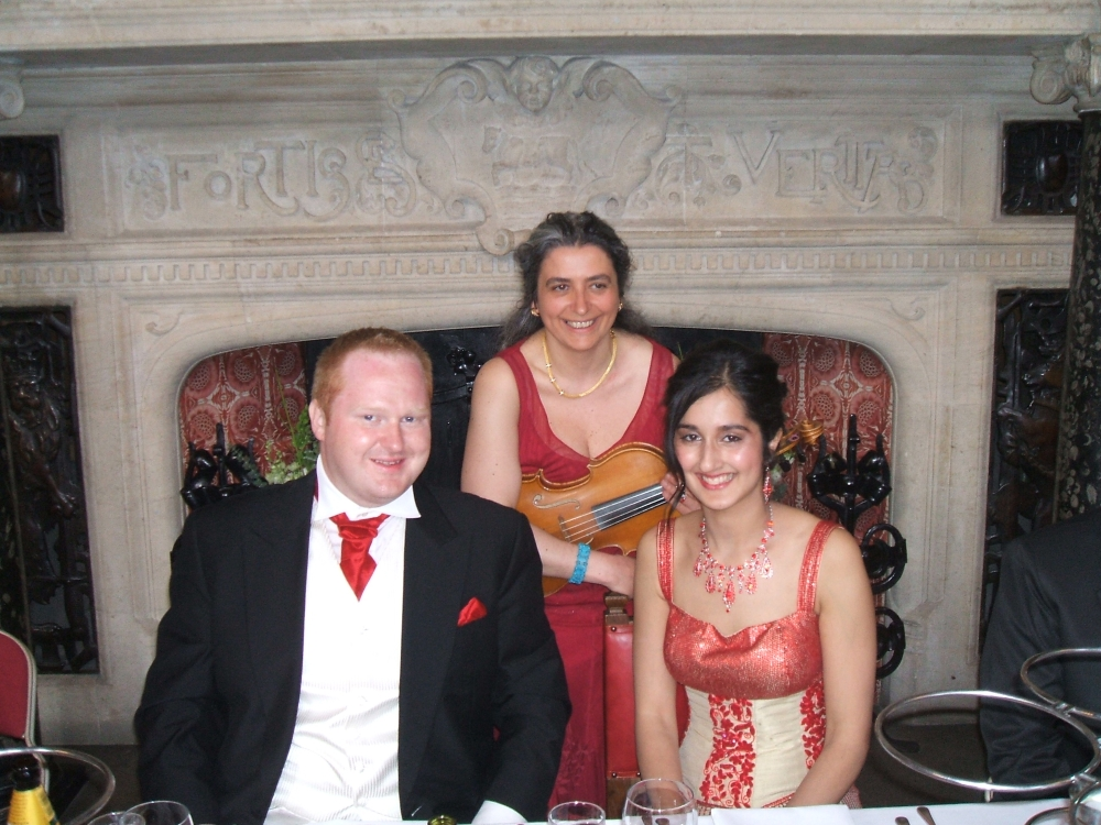 Professional wedding musician in Oxford's Town Hall Assembly Room with another happy couple: bride and groom just after their civil ceremony. Your favourite music played on the mellow viola
