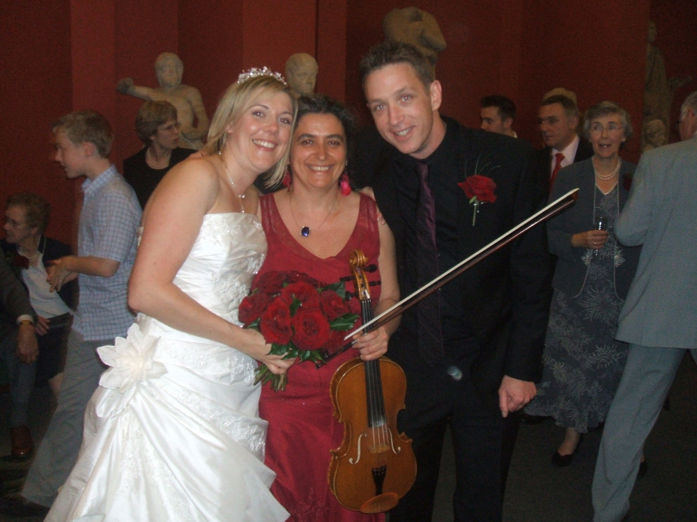 Professional wedding musician in Oxford at a reception in the Ashmolean Museum, amid ancient statues. Violin, viola. Ceremony, reception, your favourite music played on the mellow viola