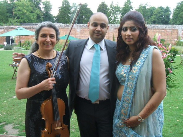 Professional Asian wedding musician with the same couple on their wedding reception. Your favourite music played on the mellow viola